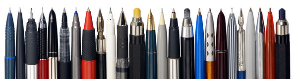 Various fountain pens, ball pens and pencils Stock Image