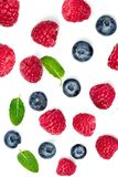 Various fresh berries isolated on white background, close up. Fl. Ying Strawberry, Mint, Raspberry and Blueberry Royalty Free Stock Photos