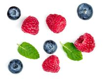 Various fresh berries isolated on white background, close up.  M. Int, Raspberry and Blueberry Royalty Free Stock Photo
