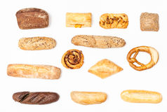 Various fresh buns and loaves on white background royalty free stock photo