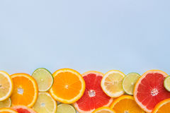 Various fresh citrus fruits on the blue background with copy space. Top view Stock Photography