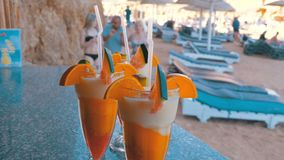 Various Fresh Exotic Cocktails or Juices in Glass with Straw on the Beach Bar. Egypt, Red Sea. stock video