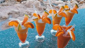 Various Fresh Exotic Cocktails or Juices in Glass with Straw on the Beach Bar. Egypt, Red Sea. stock video footage