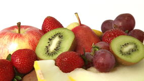 Various fresh fruit. Rotating pile of various fresh fruit. Isolated on a white background stock video footage