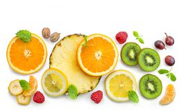 Various fresh fruit slices. Composition of various fresh fruit slices and berries isolated on white background, top view stock photography
