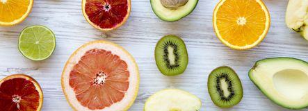 Various fresh fruits on white wooden table, overhead view. Summer background royalty free stock image