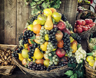 Various fresh fruits in the wicker baskets, healthy food, market Stock Photo