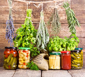 Various fresh herbs and canned food Royalty Free Stock Images