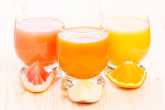Various fresh juice in glass on wooden table. Stock Photos