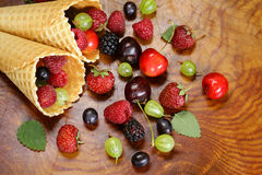 Various fresh organic berries in waffle cone Stock Image