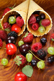 Various fresh organic berries in waffle cone Royalty Free Stock Photo
