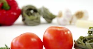Various fresh raw vegetables on white background stock video