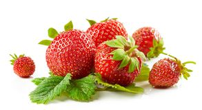Fresh red strawberries with green leaves Stock Photo