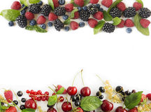 Various fresh summer berries. Ripe raspberries, blueberries, blackberries, redcurrants, blackcurrants, mulberries and cherries on white background. Berries at Stock Photo