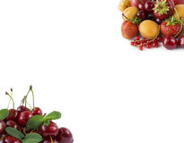 Various fresh summer berries. Ripe strawberries, redcurrants, apricots, nectarines and cherries on white background. Stock Image