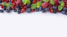 Various fresh summer berries on white background. Stock Photos