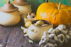 Various fresh vegetables and ceramic pot on wooden table. Cooking, healthy or vegetarian eating concept. Stock Photo