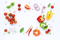 Various fresh vegetables and herbs on white background. Healthy eating concept. Top view stock images