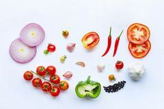 Various fresh vegetables and herbs on white background. Healthy eating concept. Top view royalty free stock photo