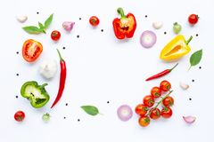 Various fresh vegetables and herbs on white background. Healthy eating concept. Top view royalty free stock image