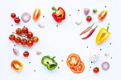 Various fresh vegetables and herbs on white background. Healthy eating concept. Top view royalty free stock images