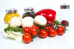 Various fresh vegetables, mushrooms  and spices on white backgro Stock Photos