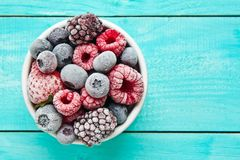 Bowl of frozen berries. Frozen berries Stock Photography