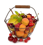 Various fruit in a basket Stock Images