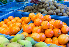 Various fruit in blue crates on market Royalty Free Stock Photography