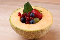 Various fruit in melon Stock Photo