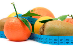 Various fruit and a tape royalty free stock images