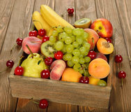 Various fruit in a wooden box Royalty Free Stock Photo