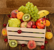 Various fruit in a wooden box Royalty Free Stock Photography