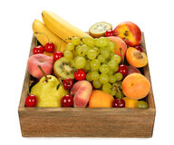 Various fruit in a wooden box Stock Photo