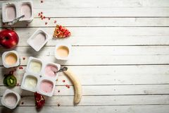 Various fruit yoghurts. Royalty Free Stock Images