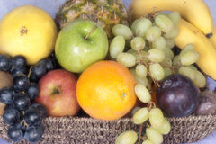 Various fruits in a basket. Healthy nutricious fruits in a basket Royalty Free Stock Photos