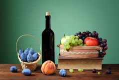 Various fruits with a bottle of vine Royalty Free Stock Image