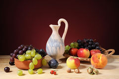 Various fruits and a ceramic jug Royalty Free Stock Image