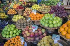 Various fruits on fruit market in Funchal, many types of passion fruit, prices. Products in brown wicker baskets Royalty Free Stock Photos