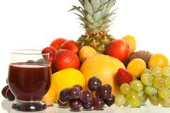 Various fruits and a glass of fresh juice Stock Images
