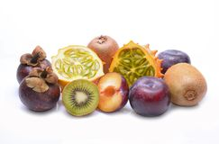 Various fruits: kiwano, mangosteen, plums and kiwi on white background Royalty Free Stock Photos