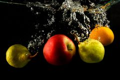 Free Various Fruits Pear, Orange And Apple Splash Of Water On Black Stock Images - 130273434