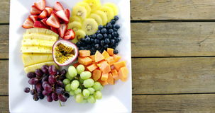 Various fruits in tray. Overhead view of various fruits in tray stock footage