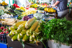 Various fruits and vegetables on the farm market in the city. Fruits and vegetables at a farmers market Stock Photos