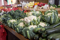 Various fruits and vegetables on the farm market in the city. Fruits and vegetables at a farmers market Royalty Free Stock Photo