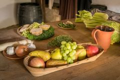 Various fruits and vegetables lying on an old wooden table royalty free stock photo