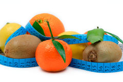 Various fruits wrapped around a tape Royalty Free Stock Photo