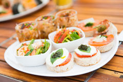 Various fusion food appetizers on dish Royalty Free Stock Photos