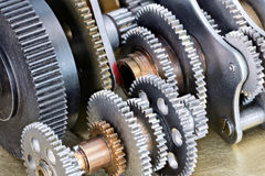 Various gear cogwheels on scratched metal industrial background Royalty Free Stock Images