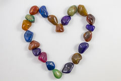 Various Gems and Crystals in a heart stock image